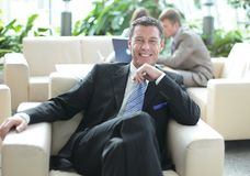 Happy middle age businessman looking at camera and smiling Royalty Free Stock Photos