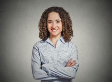 Happy, confident, successful young professional woman. Closeup portrait, happy, confident, successful young professional woman in blue shirt with arms crossed Stock Images
