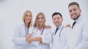 Happy and confident team of doctors posing on camera Stock Image