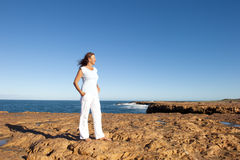 Happy confident woman at ocean background Stock Photos