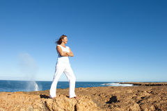 Happy confident woman at ocean background Royalty Free Stock Photo