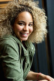 Happy confident young african american woman smiling Royalty Free Stock Photos