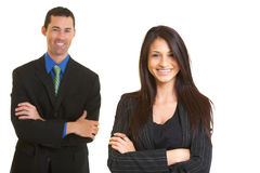 Happy confident young businesswoman with male colleague Royalty Free Stock Photo