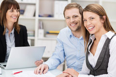 Happy confident young couple in a meeting royalty free stock photos