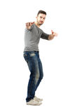 Happy confident young man with thumbs up gesture Stock Photography