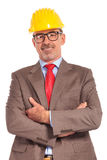 Happy construction engineer standing with hands crossed Royalty Free Stock Photography