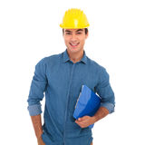 Happy construction engineering student holding clipboard is smil. Ing on white background Stock Images