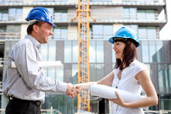 Happy construction specialists sealing the deal Stock Image