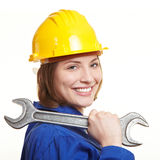 Happy construction worker. With helmet carrying big wrench on shoulder Royalty Free Stock Photos