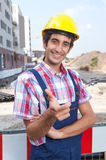 Happy construction worker with black hair Stock Photography