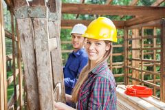 Happy Construction Worker With Colleague At Site Royalty Free Stock Photography