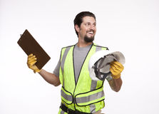 Happy construction worker with a hardhat and a clipboard Stock Image