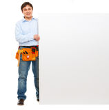 Happy construction worker holding blank billboard Stock Photography
