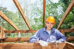 Happy Construction Worker Holding Hammer At Site Stock Photos