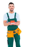 Happy construction worker holding house model Stock Photos