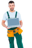 Happy construction worker holding laptop Stock Images
