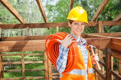 Happy Construction Worker Holding Pipe And Hammer Royalty Free Stock Photos