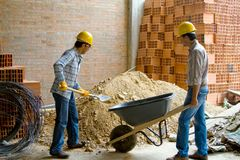 Happy construction workers Stock Images