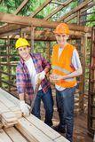 Happy Construction Workers Working At Site Stock Photo