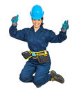Happy constructor worker woman jumping Royalty Free Stock Photo