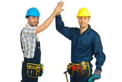 Happy constructor workers high five. Two happy constructors workers giving high five isolated on white background stock image