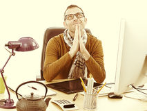 Happy contemplating casual entrepreneur zen praying at desk, retro effects Royalty Free Stock Photo