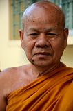 Happy and content Thai Buddhist monk in robes. Hat Yai, Thailand - August 28, 2015: A Thai Buddhist monk with a large mole on the right side of his chin smiles Stock Images