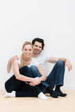 Happy contented couple in their new home Stock Photography
