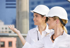 Happy contractors. In a front of building site stock photo