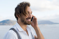 Happy conversation at phone Stock Photos