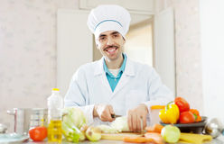 Happy  cook does veggie lunch  from vegetables Royalty Free Stock Image