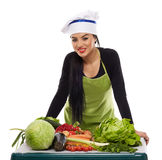 Happy cook with a table of vegetables Royalty Free Stock Photos