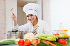 Happy cook in white uniform  with ladle Stock Image