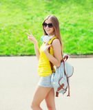 Happy cool girl wearing a headphones, sunglasses and backpack Royalty Free Stock Photos