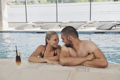 Happy cople relaxing  at swimming pool Stock Images