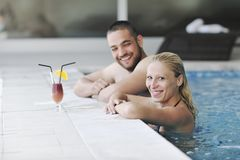 Happy cople relaxing  at swimming pool Stock Photography