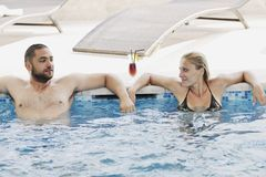 Happy cople relaxing  at swimming pool Royalty Free Stock Images
