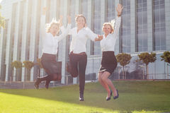 Happy corporate business women jumping royalty free stock image