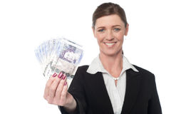 Happy corporate woman holding cash Stock Photo