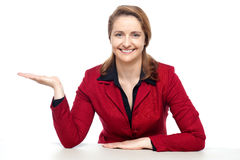 Happy corporate woman presenting copy space Stock Image