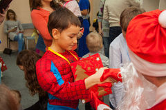 Happy Costumed boy gets presents from santa Stock Photography