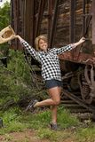 Happy Country Girl. A cute girl wearing a plaid shirt with a happy smile on her face Royalty Free Stock Images