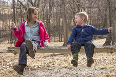 Happy country kids outside on the swing Royalty Free Stock Photo