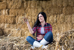 Happy country woman on the straw Stock Photos