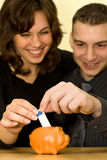 Happy couple 1. The young couple saving money Royalty Free Stock Photo