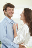 Happy couple. Portrait of happy couple dressing in the morning at home, smiling Royalty Free Stock Photography