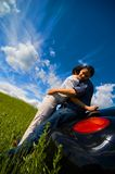 Happy Couple. A happy couple on a road trip embrace each other Stock Photos