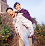Happy couple. Happy Chinese couple is taking a photo when the sunset Royalty Free Stock Photography
