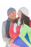 Happy couple. Happy smiling couple hugging on sunny day outdoors with kite stock photo