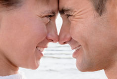 Happy couple. Profiles of smiling man and woman on a background of a surf Stock Photo